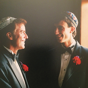 Lester and Joel Mosbacher smile at each other at Joel's wedding, in 1992. Lester was murdered later that year.