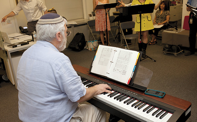 Zalmen Mlotek of Teaneck, artistic director of the National Yiddish Theatre — Folksbiene, plays piano at the rehearsal.