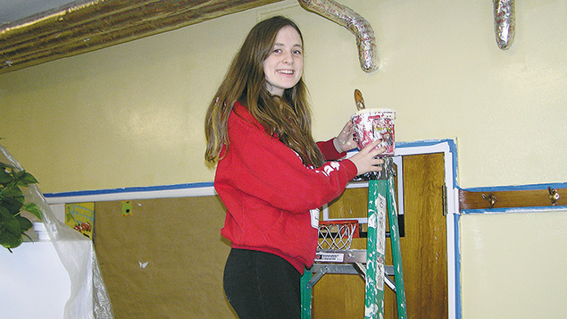 A volunteer prepares a wall. (Courtesy Safely@Home)