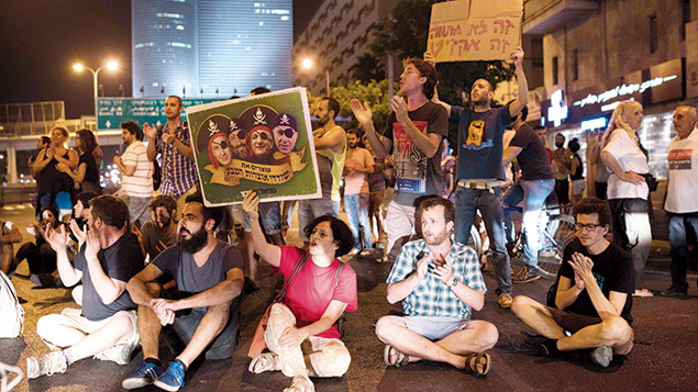 Demonstrators in Tel Aviv this week protest the Israeli government's support for a deal that would give two energy companies control over development of most of Israel's offshore gas deposits. Kelmer/Flash90
