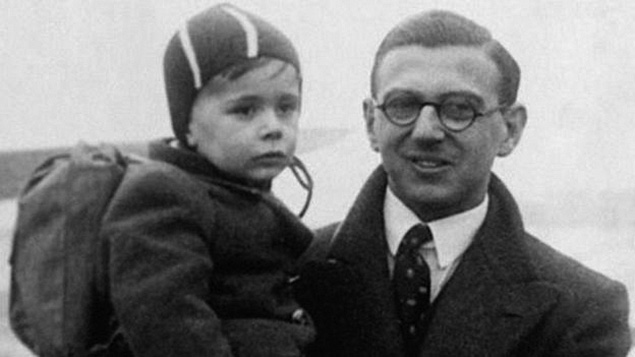 Nicholas Winton holds a child he rescued. (Photos courtesy Chabad)