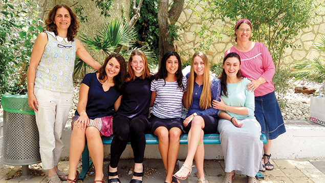 Michelle Bensadigh, center, is surrounded by other National Service volunteers from abroad. Her school adviser, Dalia, stands at the left, and Asnat Rotem, a coordinator for Bat Ami, stands at the right.