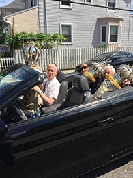 The sifrei Torah rode to their new home in an open covertible on a glorious summer day. (Peter D. Savitt)