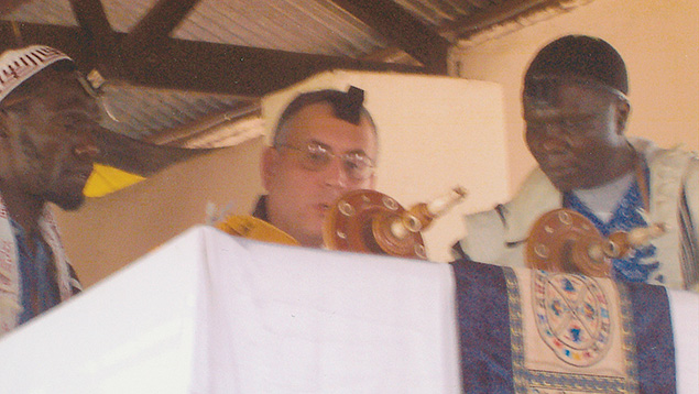 Rabbi Joseph Prouser reads from a Torah scroll he brought to Nasenyi in 2002.