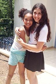 Rachel Kraft and camper hug. (Courtesy Rachel Kraft)