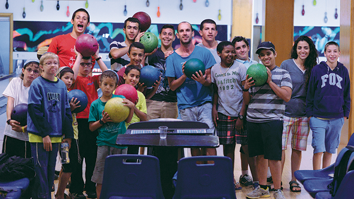 Campers go bowling this summer.