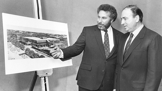 Alan Abrams and Gary Plotnick look at drawings of the new building which opened in 1987.