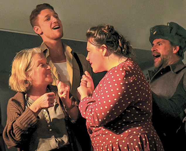 """Members of the cast raise their voices in the musical drama """"Soviet Zion."""""""