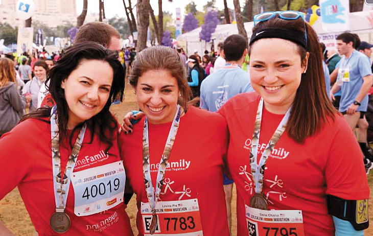 Chedva Breau, at left, stands with Pia Levine, a terror victim, and a friend at the Jerusalem marathon.