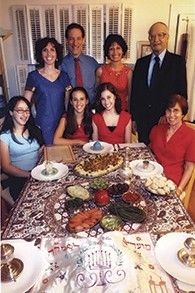 The author and her family; she is standing at the left, wearing a blue dress.