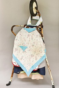 """""""Woman of Valor"""" is made from a wheelbarrow frame and six aprons."""