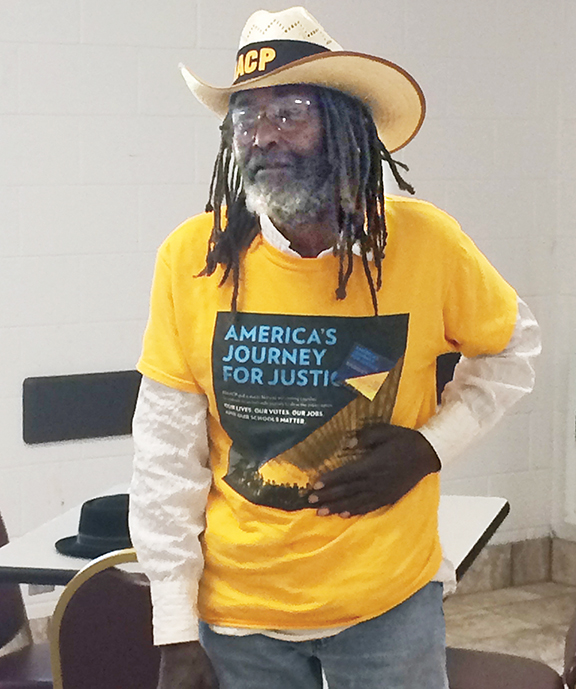 Middle Passage, a disabled veteran and longtime activist, plans to carry the American flag along the entire route.
