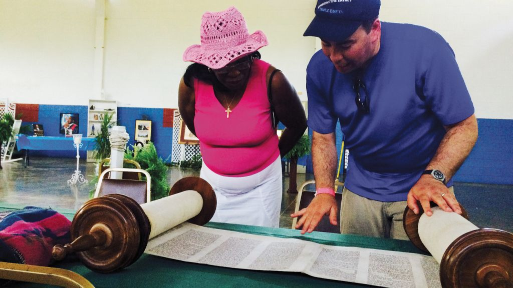 After the day's march, Rabbi Sirbu showed a fellow marcher the inside of the Torah scroll.