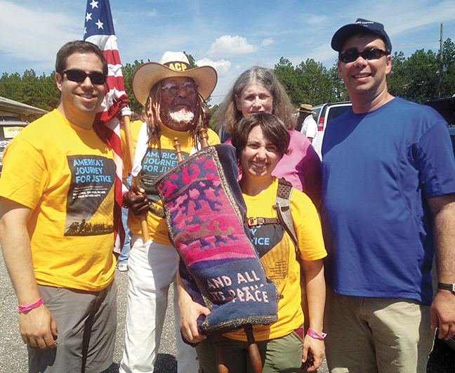 Rabbi Neil Hirsch of Western Massachusetts, Middle Passage, Rabbi Jordana Schuster Battis of Needham, Mass., Temple Emeth member Jaime Rubin of Tenafly, and Emeth's Rabbi Steven Sirbu stand with the flag and the Torah.