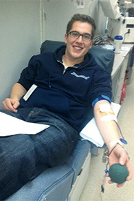 Michael Chananie donates blood at a previous Jewish Federation Mitzvah Day blood drive.