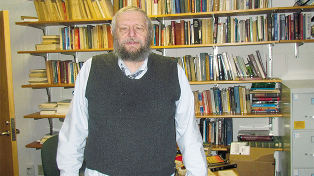 Richard Sugarman, a professor of Jewish philosophy and a close friend of Bernie Sanders, in his University of Vermont office. (Ron Kampeas)
