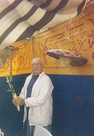 Ed Siberfarb holds the lulav in his Sukkah.