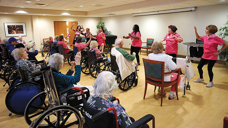 Residents take part in a pink-themed Dancercize in honor of Sharsheret's Pink Shabbat program and Breast Cancer Awareness Month.