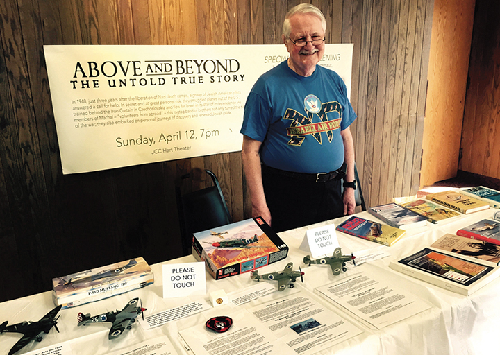 """Dr. Julian Yudelson displays his models outside a showing of """"Above and Beyond"""" in Rochester, New York. (Howard Levant)"""