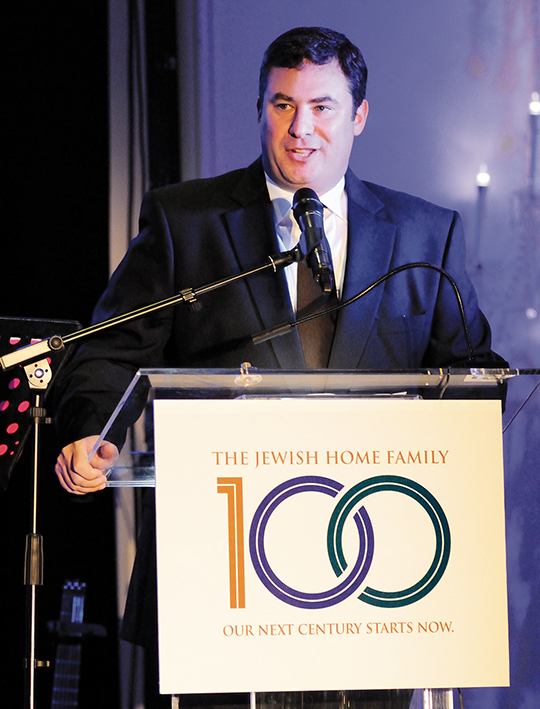 Eli Ungar speaks at the centennial gala celebration last Sunday night.