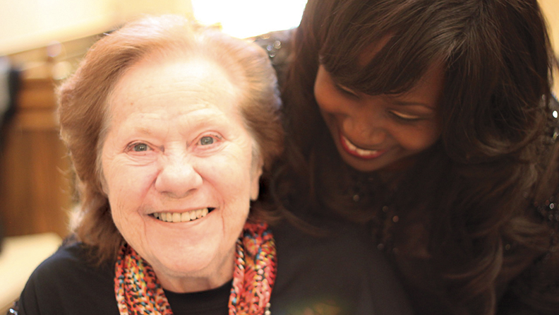 JHR resident Mitzie Krampf and its director of recreation, Tracey Couliboly, enjoy each other's company.