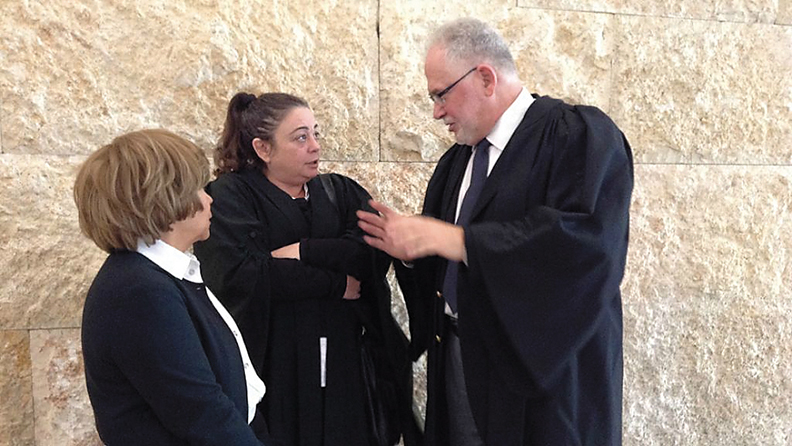 Rabbi Uri Regev with a client who was excommunicated by her charedi community for using the Israeli legal system.