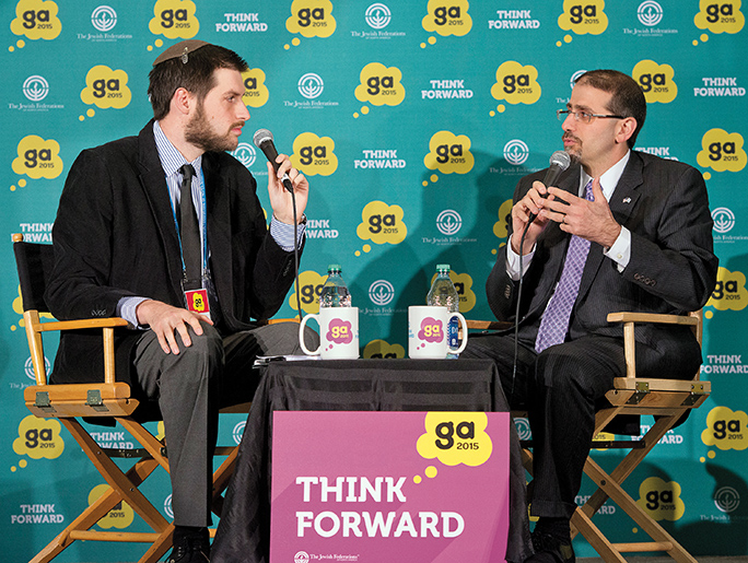 Ambassador Daniel B. Shapiro, United States ambassador to the State of Israel, right, being interviewed by Jacob Kamaras of JNS.org, left.