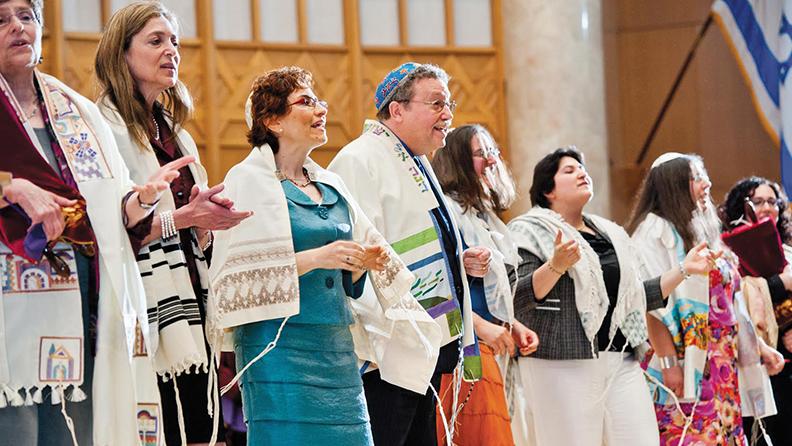 From left to right: Rabbis Doris Dyen, Anne Feibelman, Chana Leslie Glazer, Saul Oresky, Kelilah Miller, Alanna Sklover, Lori Feldstein-Gardner and Shulamit Izen on stage at the Reconstructionist Rabbinical College's 2013 graduation ceremony. (Photo courtesy of RRC/Jewish Reconstructionist Communities)