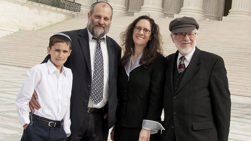 Menachem Zivotofsky, left, and his father, Ari Zivotofsky, stand in front of the Supreme Court with their attorney, Alyza Lewin, and Lewin's father, Nathan, on November 3, 2014. (Rikki Gordon Lewin)