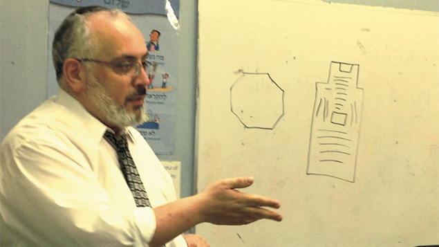 Rabbi Joseph Prouser of Temple Emanuel of North Jersey illustrates a shul in Uganda at last year's session.