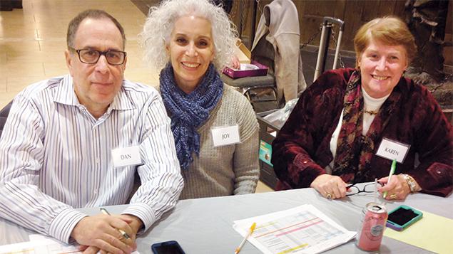 Dan and Joy Firshein and Karen Butler are greeters.