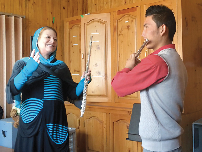 Noelle Perrin teaches flute to a high school student at the Afghan National Institute of Music.