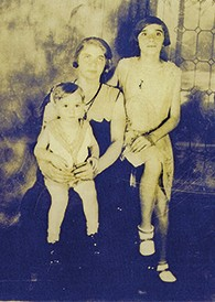 Miriam Cohen holds her young son, Sid, as her daughter, Rose, perches on the chair. The picture was taken in the early 1930s.