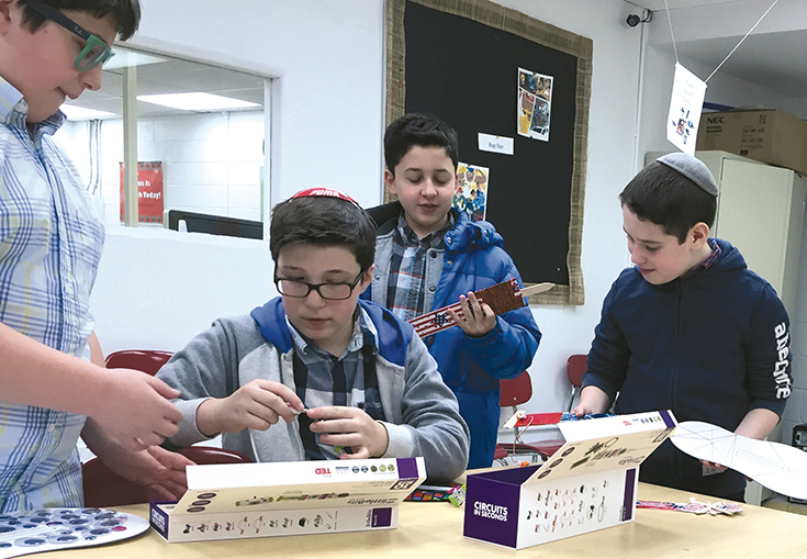 Yavneh students with Little Bit electronic kits and cardboard guitars.