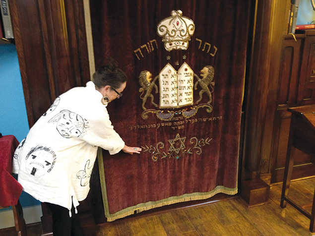 Kathleen Sukiennik, a former executive director of Congregation Beth Jacob of Galveston, Texas, shows the water line on the synagogue's Torah ark. It is a reminder of the devastation wrought by Hurricane Ike in 2008.