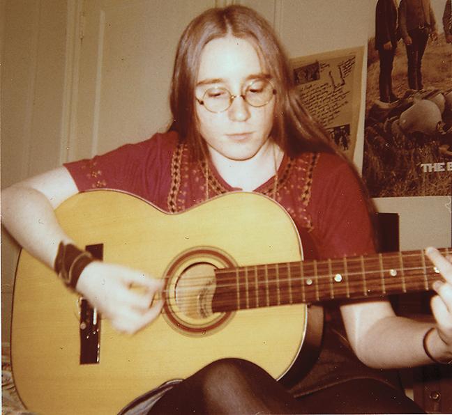 Playing guitar in 1971.