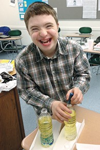A Sinai student enjoys a science lesson.