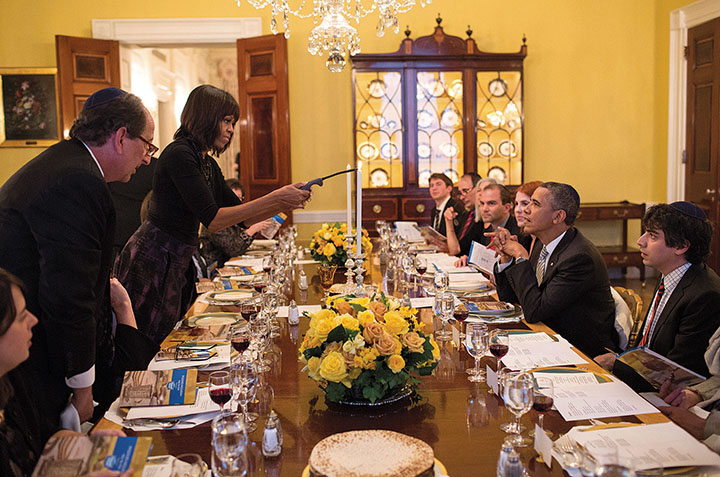Michelle Obama lights the candles at a private seder at the White House. (White House/Pete Souza)