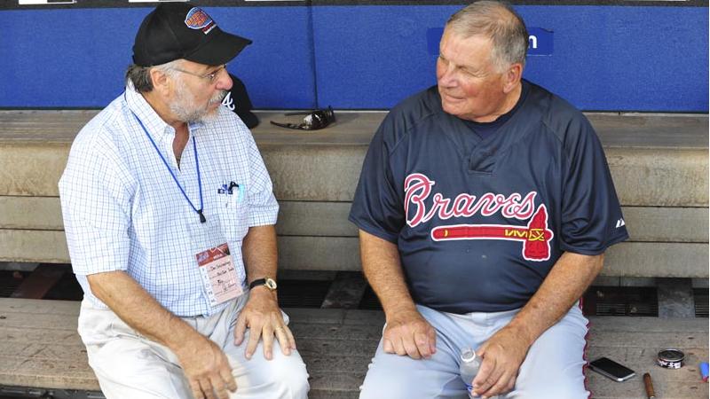 Bobby Cox, right, talking to Dan Schlossberg, was Atlanta's manager during its winning streak.