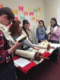 Students read Torah at Koach at Rutgers Hillel.