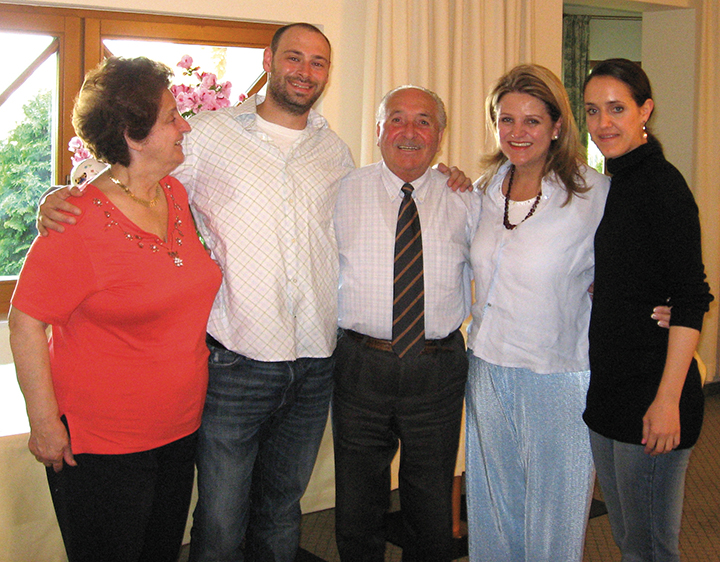 Lev Golinkin, second from left, went back to Binders, the Austrian hotel where he and his family stayed right after they got out of the Ukraine. Here he is with the owners.