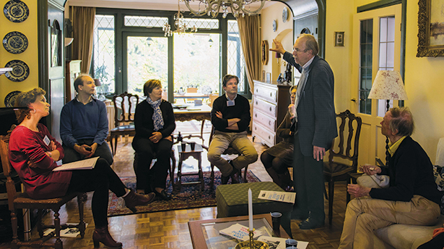 Kees van den Heuvel, standing, talks to guests about the Jewish family that once lived in what is now his home in the Netherlands town of Vught on April 30.