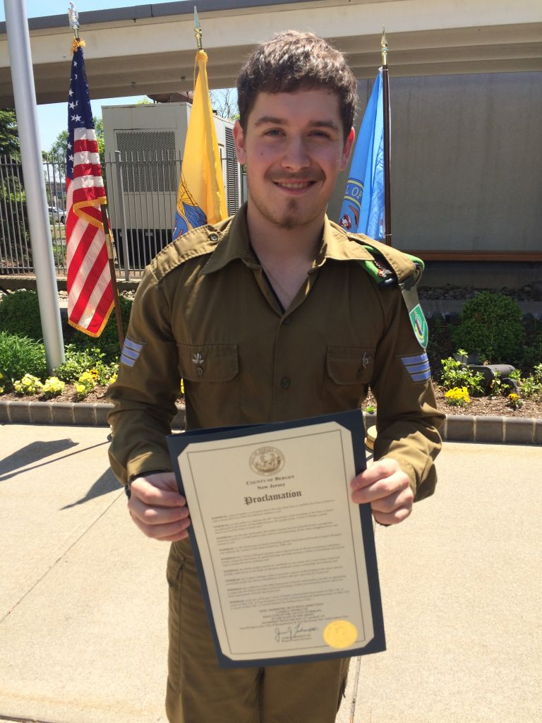 Harrison Adler holds the proclamation marking Yom Ha'atzmaut
