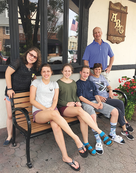 During a Bergen County trip, the whole family — Mollie, Sadie, Clara, and George Aeder, Jennifer Levine, and Jeff Aeder — pose outside an Allendale restaurant.