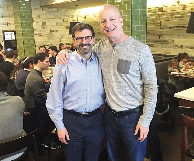 Jeff Aeder, right, stands at Milt's BBQ with Rabbi Asher Lopatin, who now heads the Bronx-based Yeshivat Chovevei Torah but before that was Mr. Aeder's neighbor and rabbi.