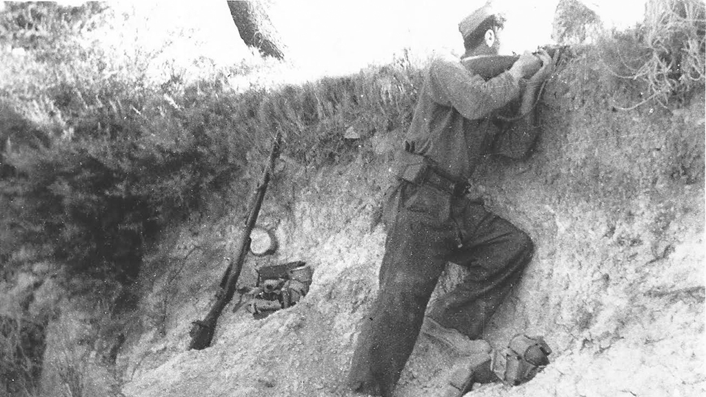 Photo of David Levine in a trench, discovered in a New York library archive.