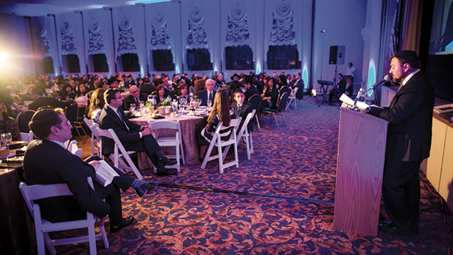 Rabbi Aryeh Stechler, head of school, addresses the 430 dinner attendees.