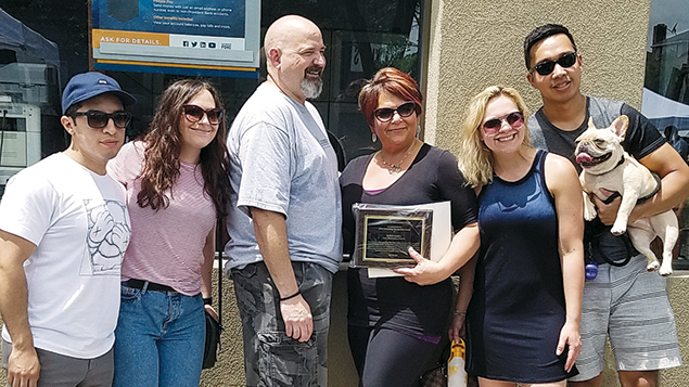 Robyn Samra, center, and her family.