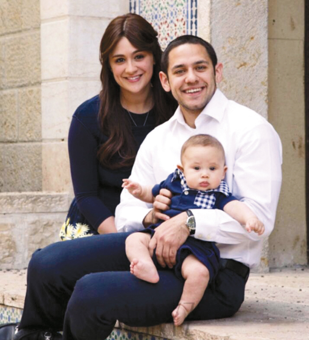 Akiva Neuman with his wife, Chani, and son, Yaakov Shmuel. (Emuni Z.)