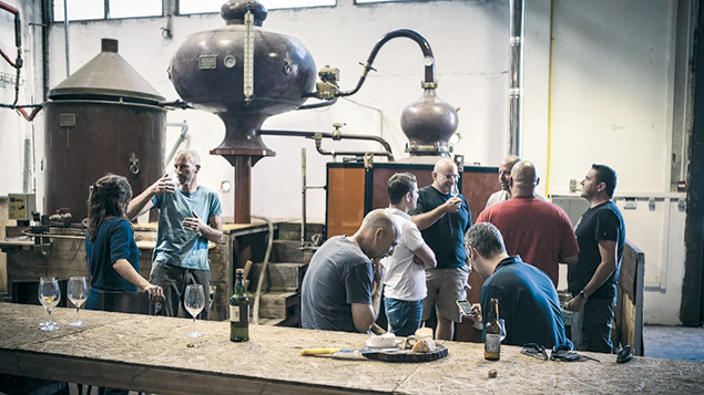 Pelter Winery is now distilling whiskey and other spirits. The still in the background is from Cognac, France, and once was used by Rémy Martin. (Courtesy of Pelter Winery)